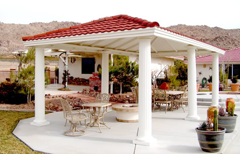 This 14′ by 24′ roman column style gazebo enhances any backyard.